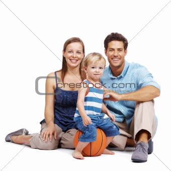 Beautiful young couple with their cute kid against white
