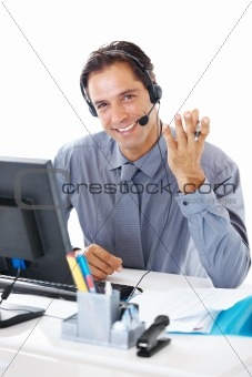 Portrait of a happy businessman with headset