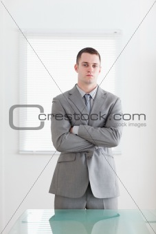 Business man with his arms folded