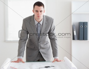 Architect standing behind a table