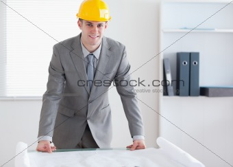 Smiling architect with helmet on