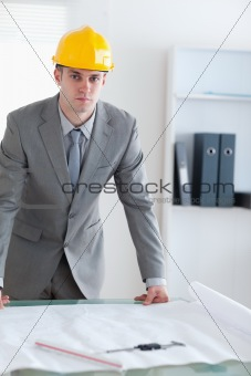 Architect with helmet on standing