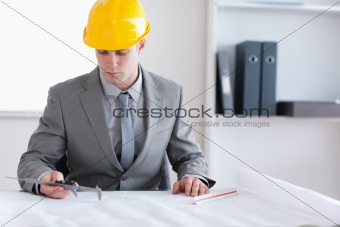 Architect checking plan