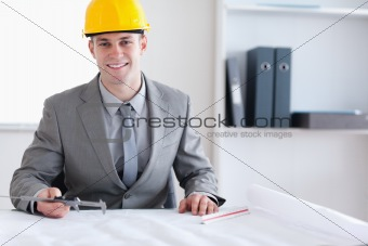 Smiling architect working on a plan