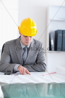 Close up of architect checking a plan
