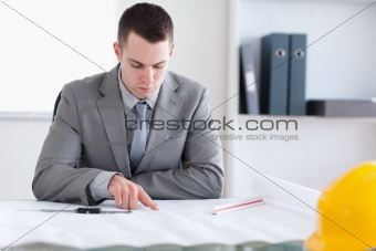 Architect checking building plan