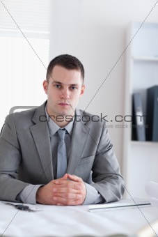 Close up of architect sitting behind a table