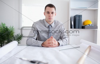 Architect sitting behind a table