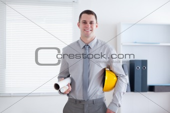 Architect carrying helm and plans