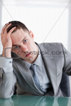 Close up of young businessman after getting bad news