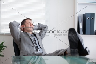 Smiling businessman taking a rest