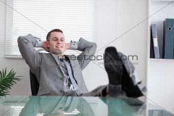 Smiling businessman taking a break