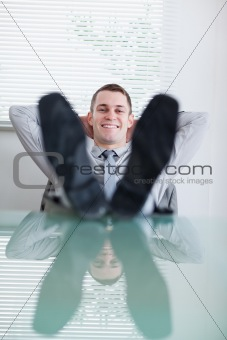 Close up of young businessman sitting back