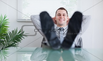 Smiling businessman sitting back