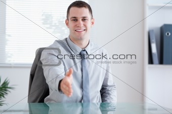 Smiling businessman greeting his negotiation partner
