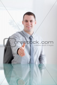 Close up of smiling businessman greeting his negotiation partner