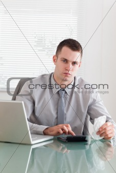 Businessman checking an invoice