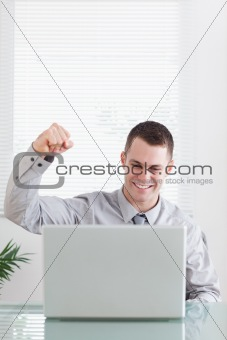 Close up of businessman happy about an email