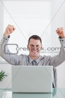 Close up of businessman celebrating a great success