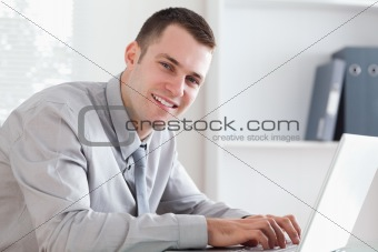 Close up of businessman typing on his laptop