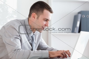 Close up of businessman writing an email with his laptop