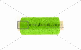 green thread bobbin isolated on white background