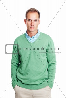 Casual young man standing against white background