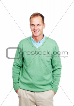 Happy young guy standing casually on white background