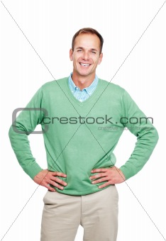 Relaxed young guy standing isolated against white background