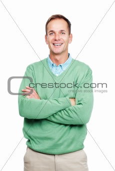 Happy young man standing with folded hands