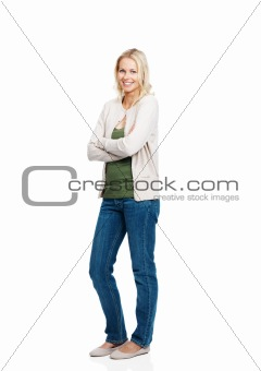 Happy young lady standing with folded hands on white