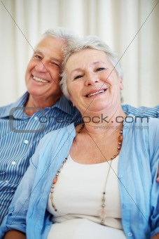 Smiling senior couple sitting together