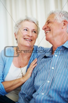 Old couple sitting together having fun