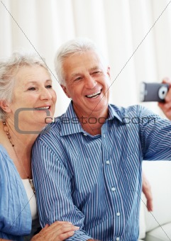Senior man taking picture with his wife