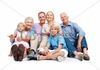 Happy family sitting together on floor