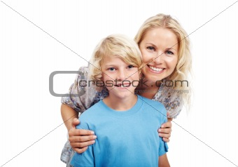 Smart young boy standing with his mom against white background