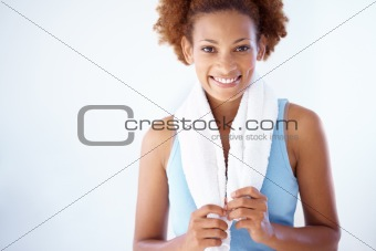 Attractive young woman holding towel and smiling