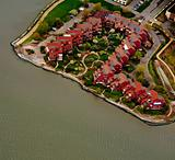 Aerial view of row houses on the bank of river