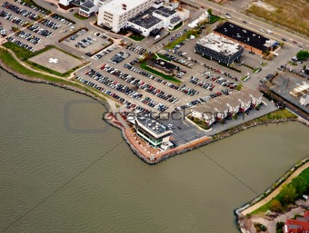 Aerial view of parking lot for vehicles on the bank of river