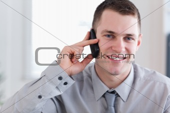 Smiling businessman getting good news on the phone