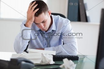 Close up of businessman frustrated with paperwork