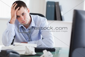 Close up of frustrated businessman doing his accounting