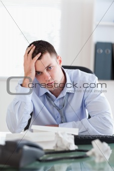Close up of businessman being unhappy about accounting