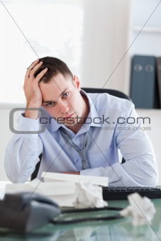 Close up of businessman being depressed by accounting