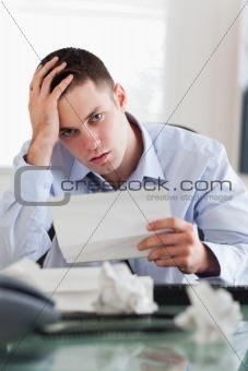 Close up of businessman worried about bills