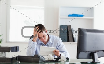 Businessman getting frightening bad news