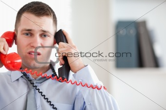 Businessman troubled by the telephone