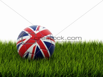 Football with united kingdom flag on grass