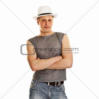 A young man in a T-shirt, jeans and a hat
