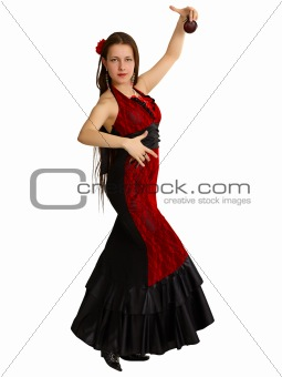 A young girl performs Spanish dance with castanets